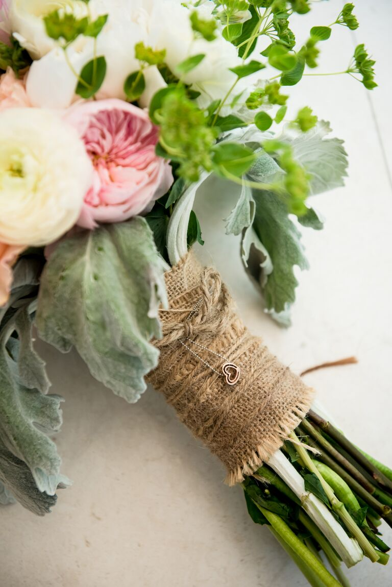 burlap-wrapped bouquet with necklace