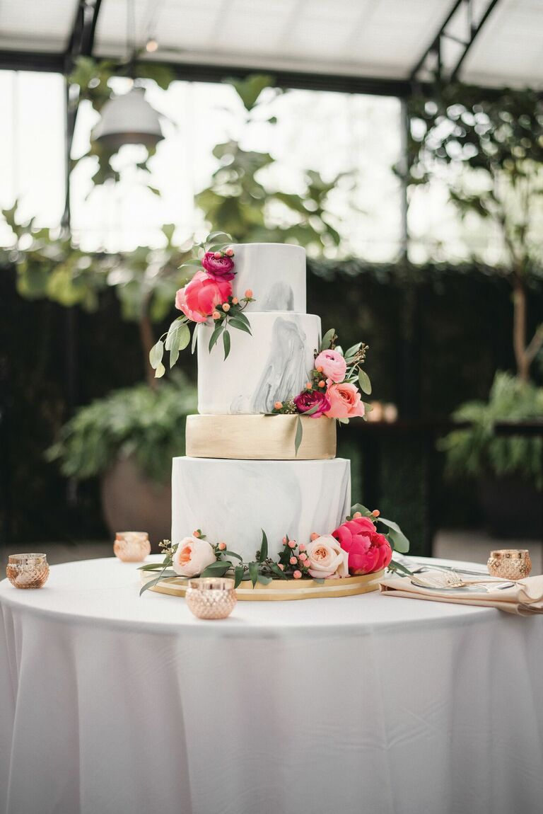 Four-tier gray marbled cake with pink peony decorations