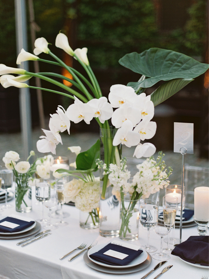 Modern tablescape with calla lilies and orchids