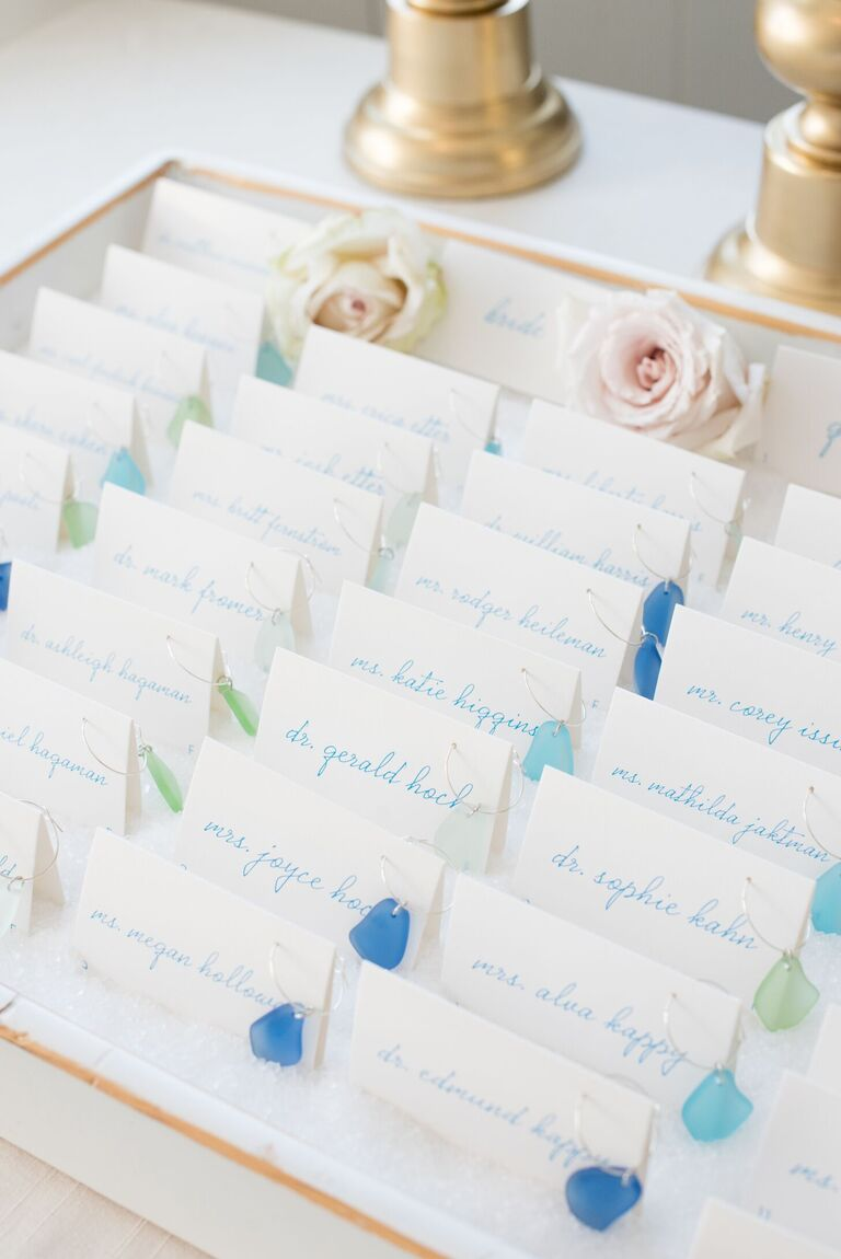 Escort cards with sea glass wine charms