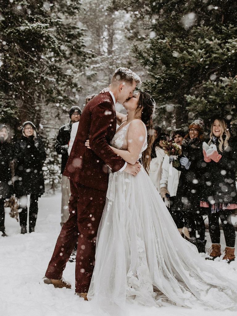 wedding season couple kissing in snow