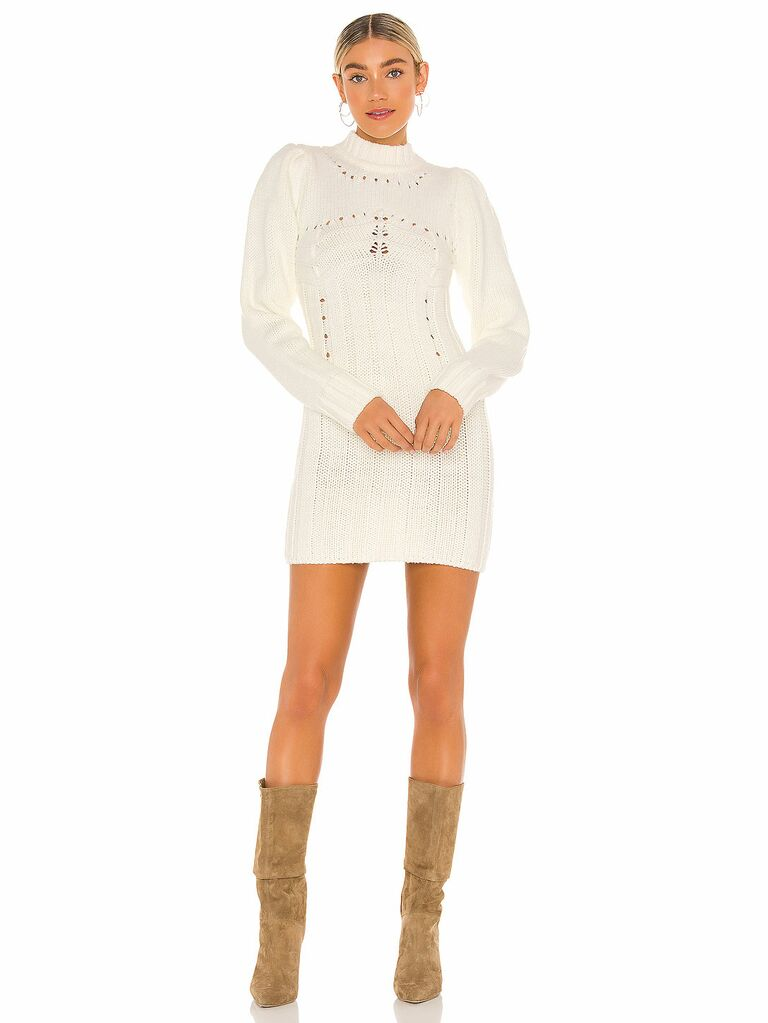 White long sleeve sweater dress with eyelet details
