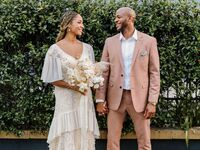 Bride wearing 1970s-style wedding dress with groom