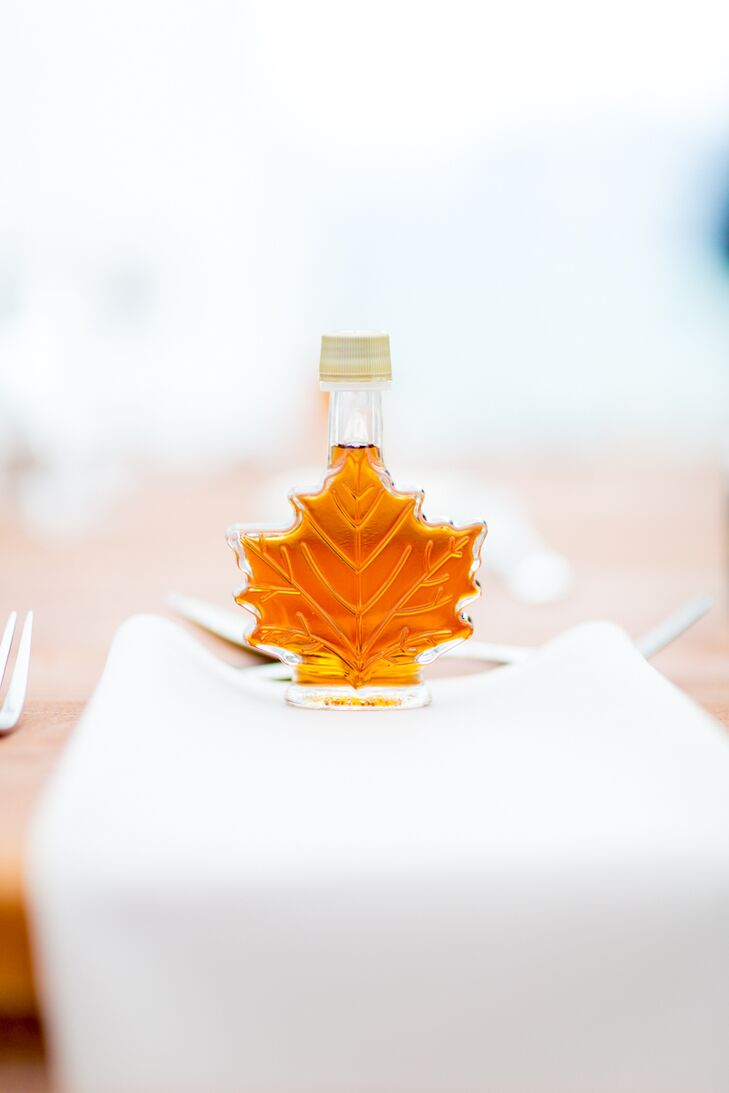 The favors, maple leaf-shaped jars of homemade maple syrup from Molly's family farm also doubled as decor, their foliage-inspired shape playing up the wedding's fall theme.