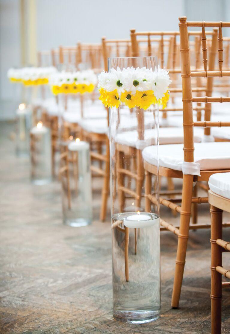 White and yellow daisy aisle decor