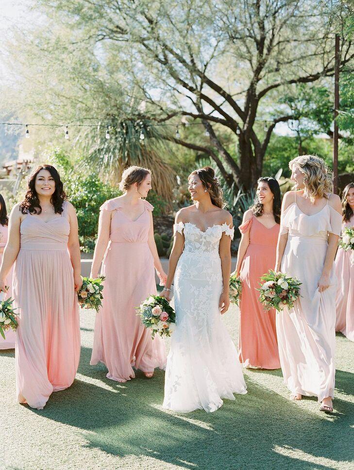 Bride Walking Beside Bridesmaids in Peach-Hued Dresses
