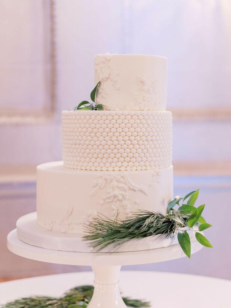 Three-tier white staircase wedding cake