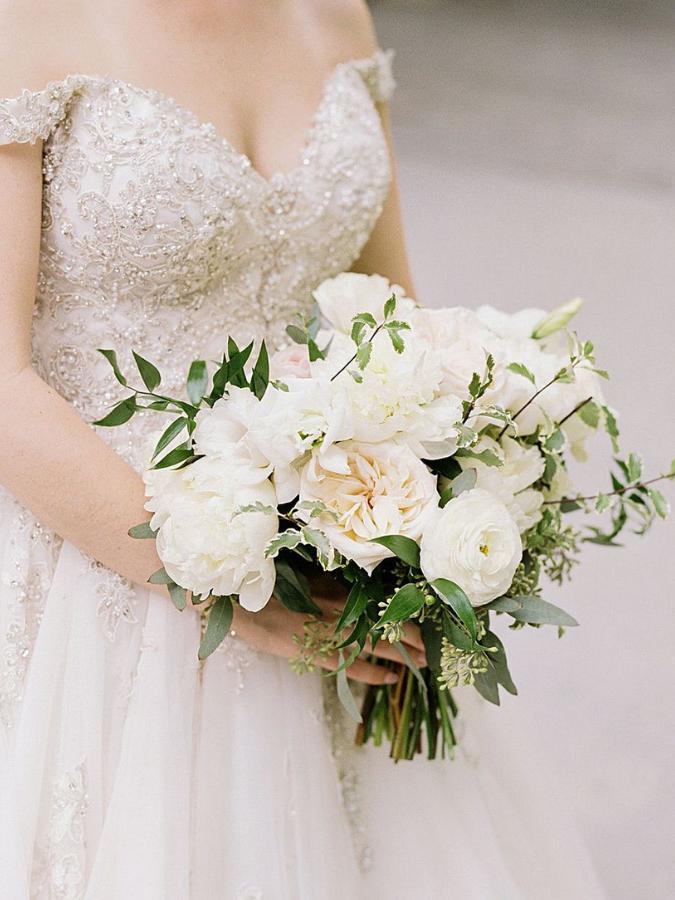 bride holding romantic wedding bouquet