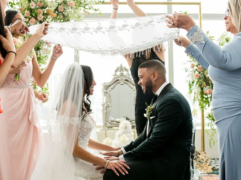 Couple exchanging vows at aisle