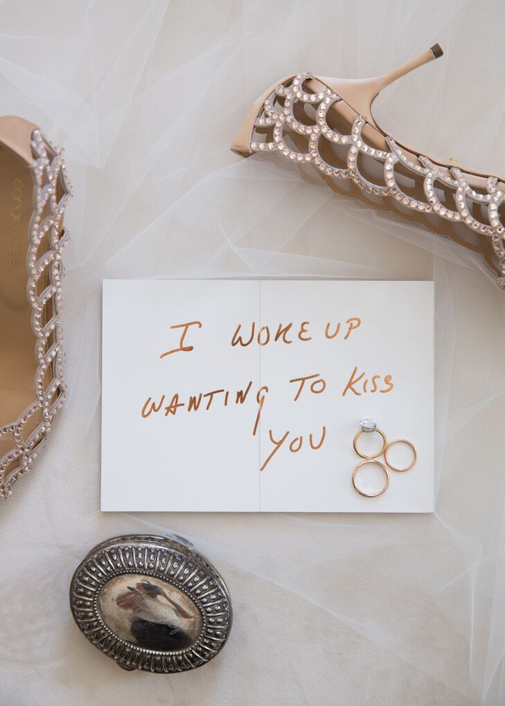 """Invitations included two cards, with one that read """"I woke up wanting to kiss you,"""" in rose gold lettering. """"It's our favorite quote,"""" Whitney says. The couple  also created a custom neon sign of the same quote that served as  the focal point of their tented reception in Bannockburn, Illinois."""