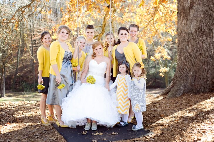 Kristy allowed her bridesmaids to select their own dress as long as they were gray and paired them with yellow cardigans.