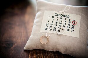 The Engagement Rings on a Calendar Pillow