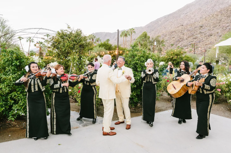Couple dancing while mariachi band plays