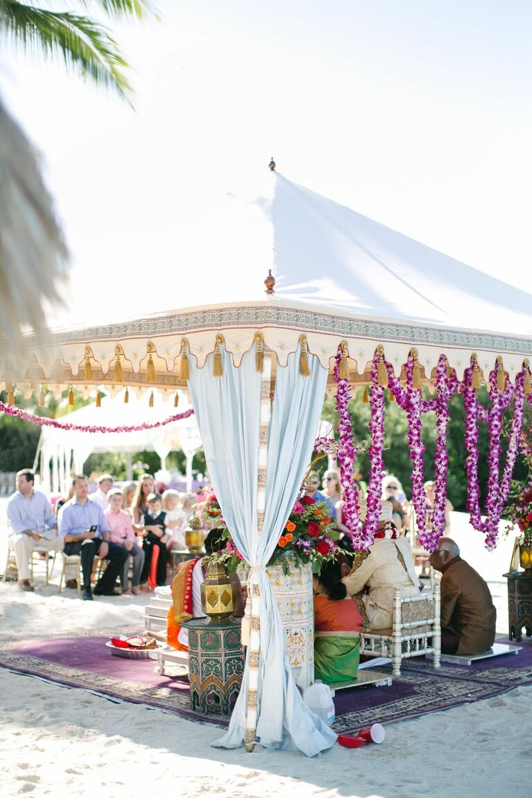 Tented mandap with purple orchid garlands