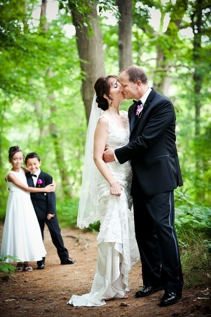 Chris' two children from a previous marriage, nine-year-old Angie and 10-year-old Tyler played integral roles in the couple's wedding day—in addition to their flower girl and ring bearer duties.
