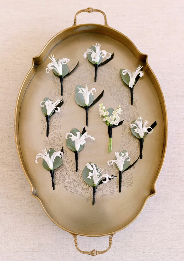 Antique tray with boutonnieres sitting on it