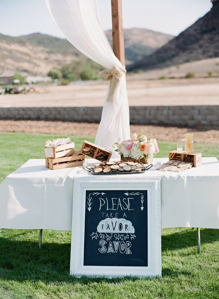 The couple made white-framed chalkboard signs that they placed throughout the reception for a rustic chic look.