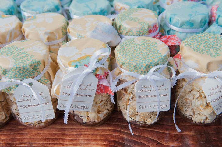 Caitlin and Sean also put a Southern twist on their wedding favors. Each of the couple's 140 guests took home a mason jar filled with flavored salt and vinegar popcorn. The jars were even topped with a vibrant printed cloth.