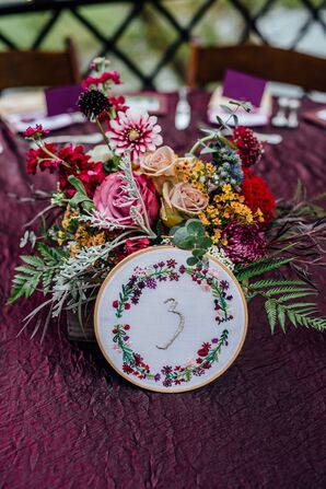 Hand-Sewn Table Numbers with  Vibrant Flower Centerpieces