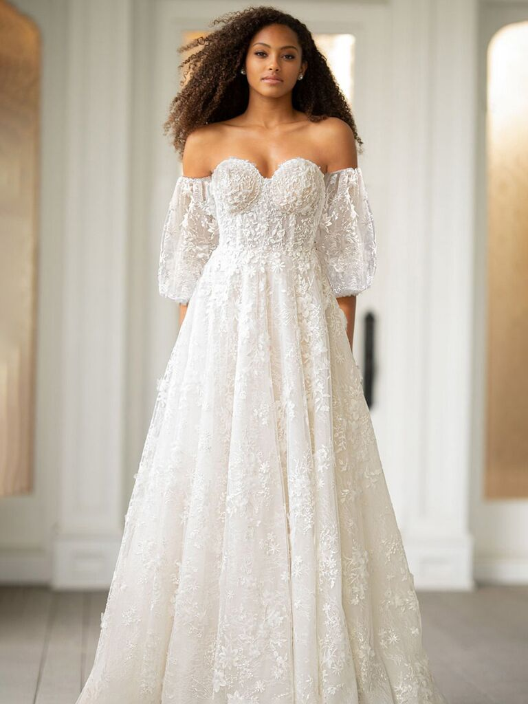 essence of australia white a line wedding dress with lace sweetheart neckline lace mid-length off the shoulder puffy sleeves and pleated flowy lace skirt