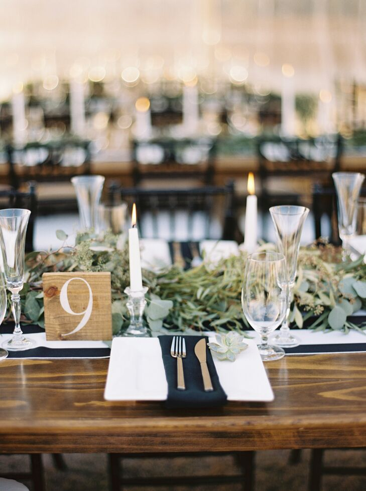 At the reception in Bakersfield, California, each long, wooden farmhouse-style table was topped with a simple black-and-white-striped runner and a medley of succulents, which guests took home as favors.