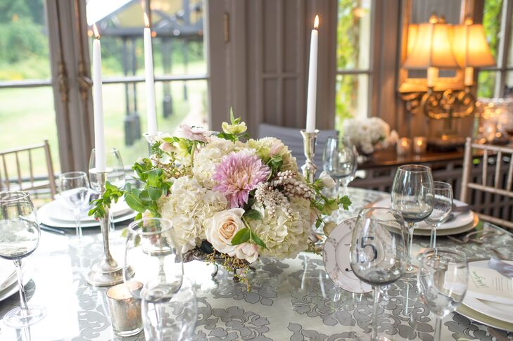 """Rachel and Jacob went for all-out romance when it came to the decor, working with the florists at Kiss Spa at Lord Thompson Manor to create high and low arrangements of elegant, romantic blooms. """"I wanted the decor to fit the gorgeous venue,"""" Rachel says. """"Lord Thompson Manor is a beautiful country estate with ivy-covered walls and greenery everywhere. I wanted the decor to look natural but elegant. Sometimes, simple is better."""""""