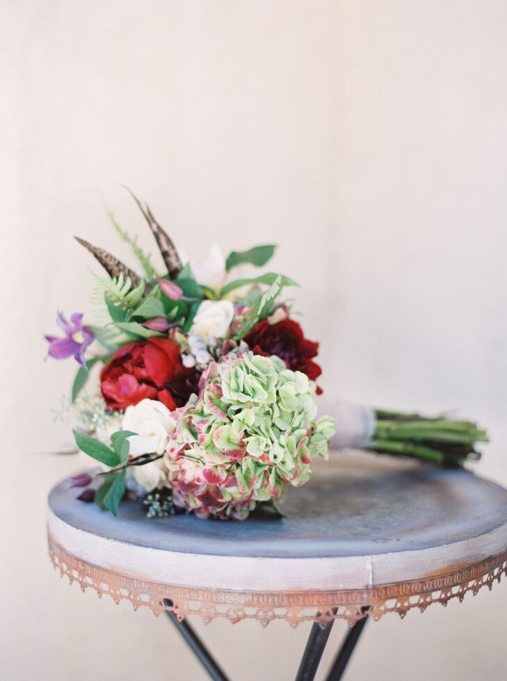 Ann carried a bouquet that she arranged with her bridesmaids, using pesticide-free blooms donated by a service that the florist worked with. This served as an affordable and eco-friendly way to bring flower arrangements to the wedding.