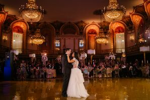 Bride and Groom at First Dance in Glamorous Ballroom