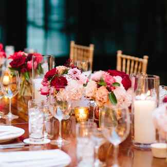 party table with pink, red and gold decorations
