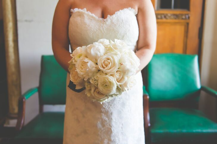 Wedding Flowers by Heidi created this lush ivory arrangement for the bride using a mix of roses and ranunculus.