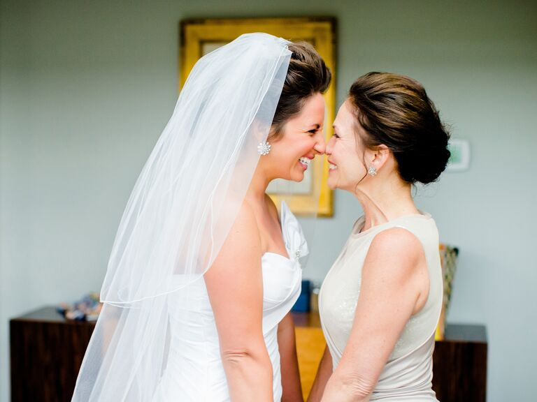 Bride and mother of the bride getting ready before ceremony