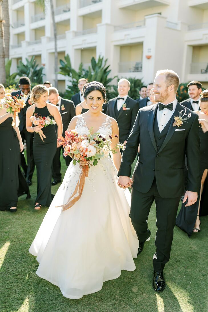 Couple with Wedding Party Dressed in Chic Black Attire