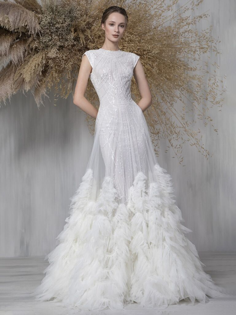 tony ward white a line wedding dress with cap sleeves and high neckline with beading and flowy tulle skirt with feathers and beading