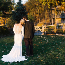 bride in lace illusion back wedding dress with groom