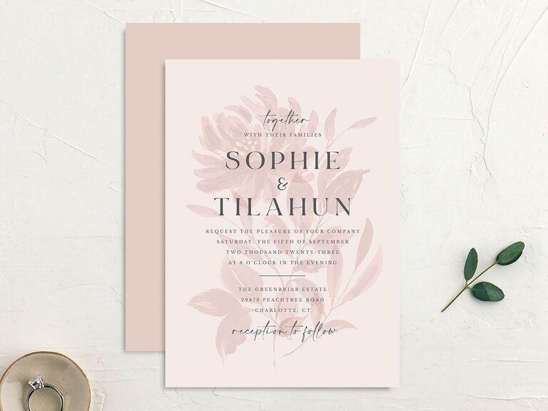 Blush pink wedding invitation with floral motif