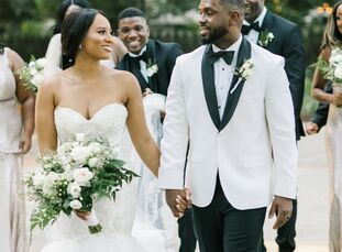 """Courtney and Gerald's theme for their Columbia, South Carolina, wedding was, """"'A Night in the Gardens,' We wanted our wedding to focus on family and f"""