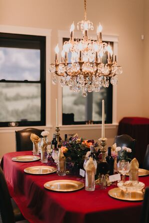 Moody Wedding Reception With Taper Candles and Chandelier
