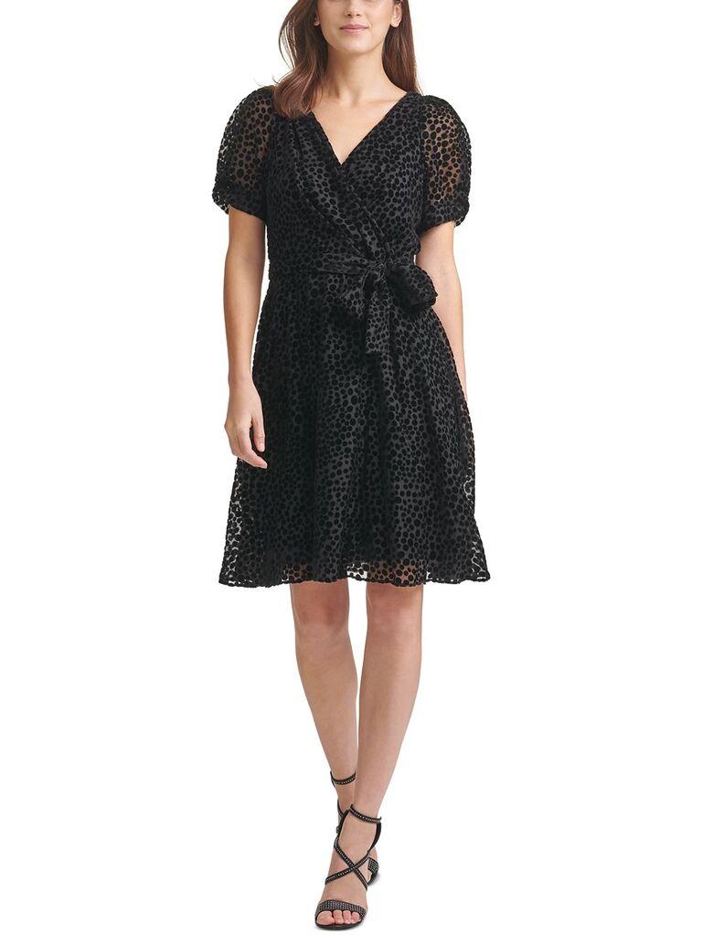 macys black velvet wedding guest dress with v neckline polka dots tie waist and mesh puffy short sleeves