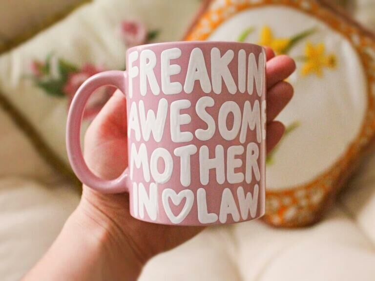Pink mug with Freakin' Awesome Mother In Law in white