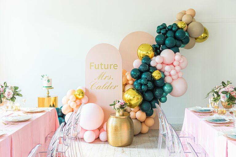 Teal-and-pink balloon installation