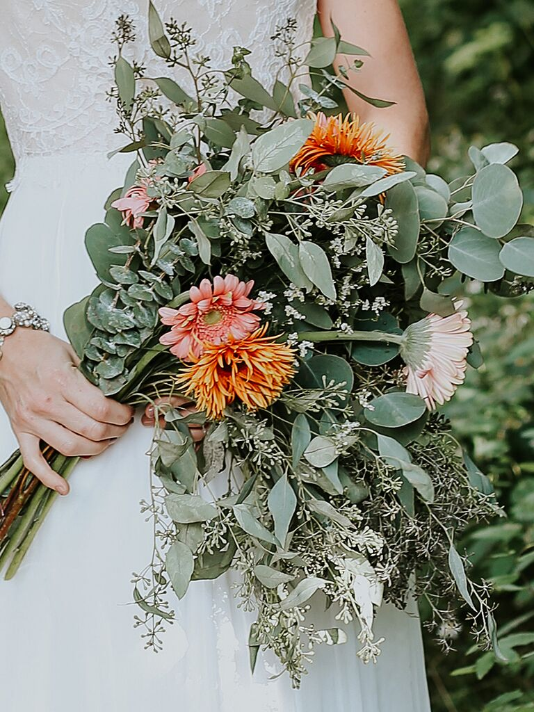 A bridal bouquet with daisies and eucalyptus