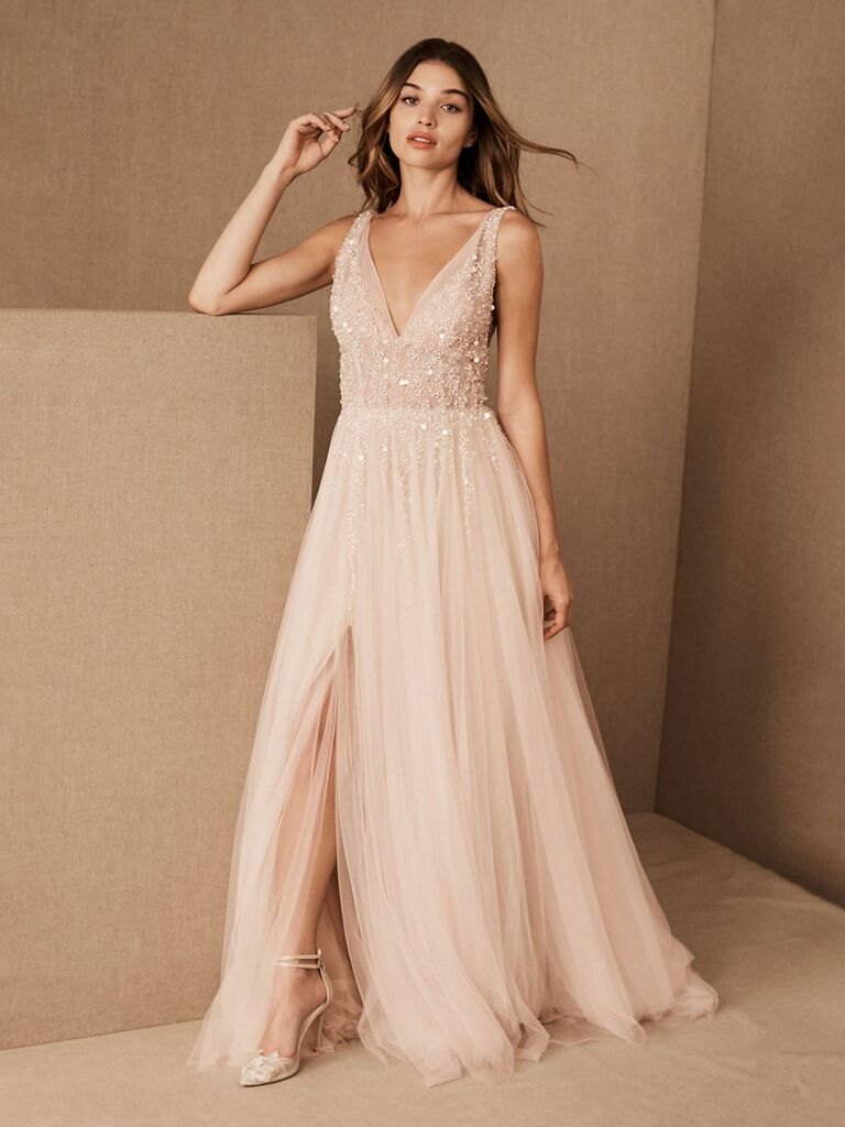 bhldn light pink a line wedding dress with thick straps v-neckline beading flowy tulle skirt and slit