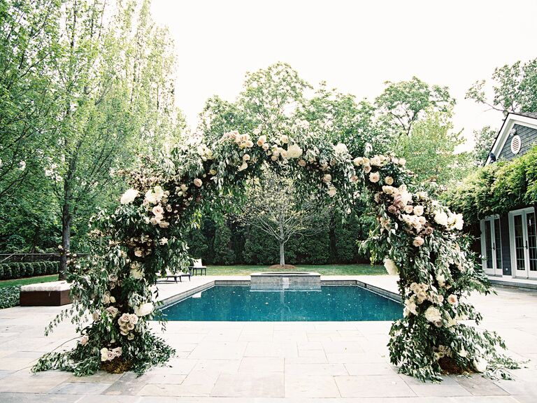 large flower-covered wedding arch
