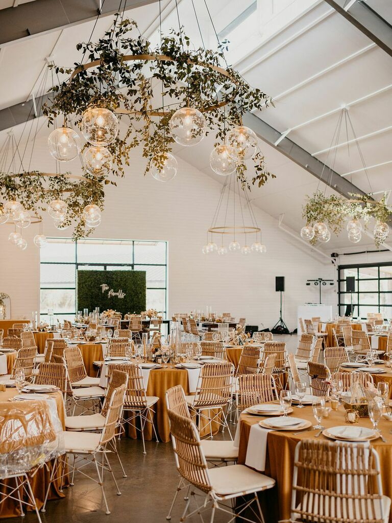 Rustic barn wedding venue with modern gold angular lighting installations