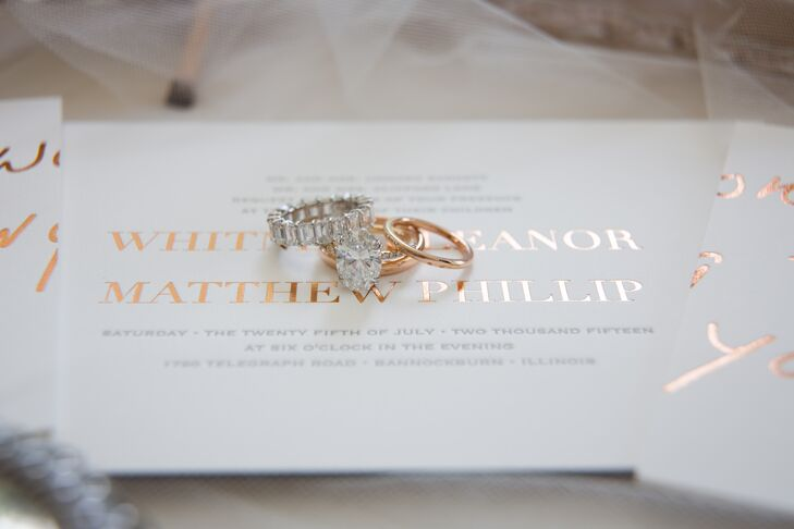 Whitney's rose gold diamond ring and band mirrored the rose gold, foil-stamped invitations.