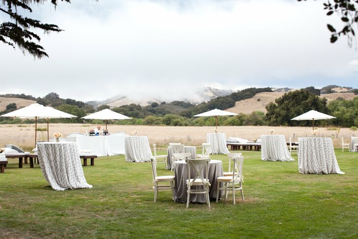 Located on the lawn next to the ceremony site, the cocktail hour area had a lounge area as well as hightop tables for the guests to enjoy.