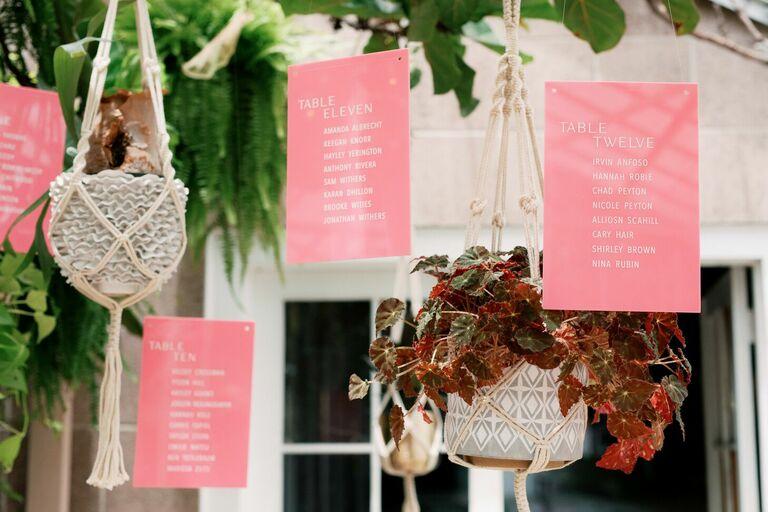 Hanging pink acrylic seating chart