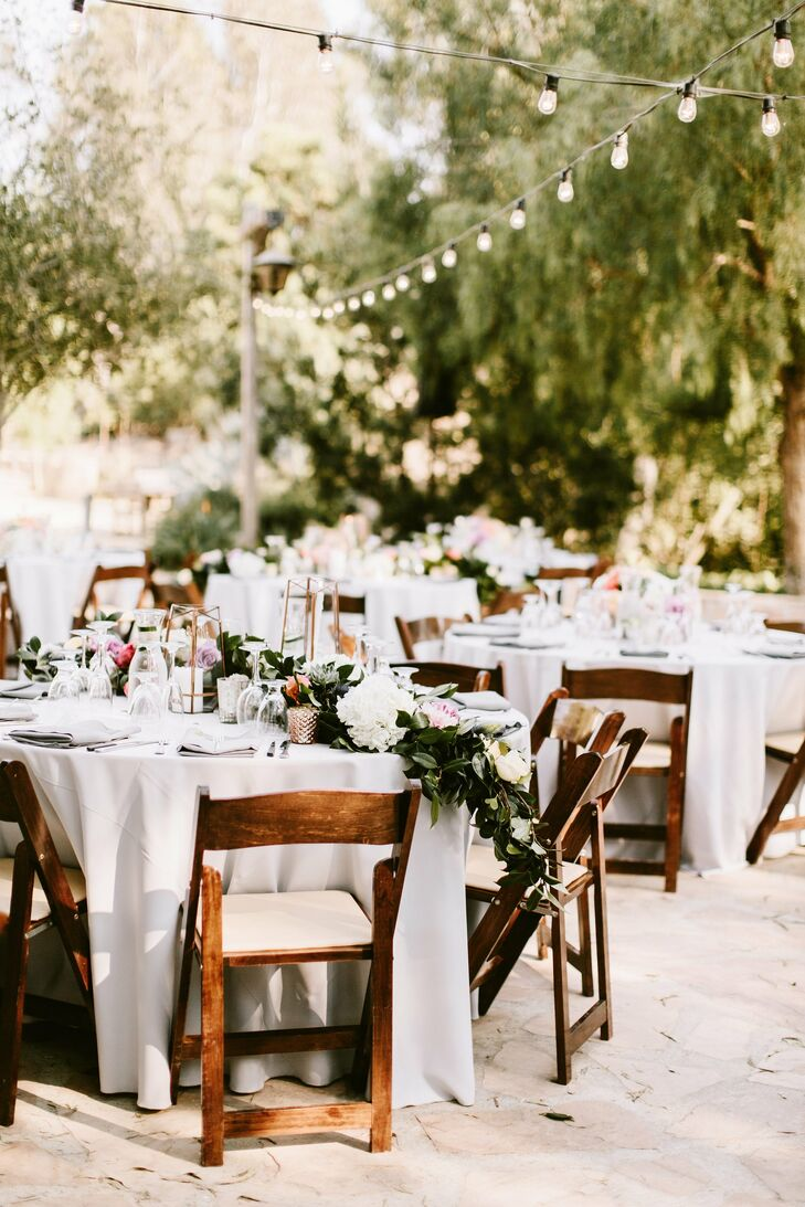 """String lights added ambiance to the outdoor reception at Leo Carrillo Ranch in Carlsbad, California. """"I wanted the whole day to feel like a casual yet elegant dinner party filled with love, laughter and lots of dancing,"""" Mira says."""