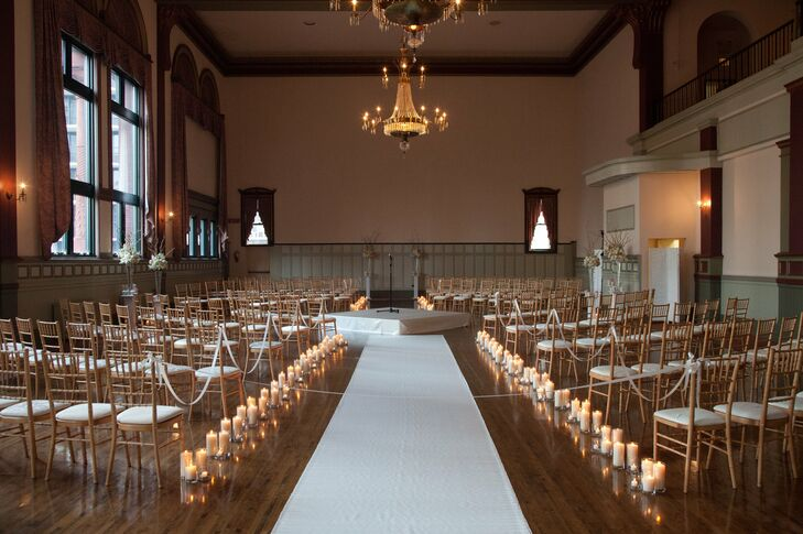 The ceremony in the round was set up in the grand ballroom of Germania Place in Chicago. Candles glistened along the aisles, strategically placed under the crystal chandeliers.