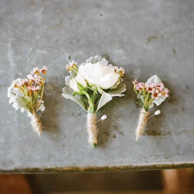 Spray roses, wax flowers and dusty miller loosely wrapped in twin had a natural look.